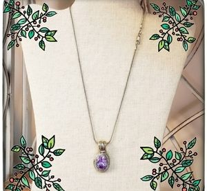 Amethyst necklace, chain is sterling silver, pendant is gold and silver tone